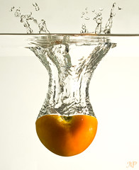 Tomato splash ! (|| Msh3L Alomran ||) Tags: white ex water fruit speed canon tomato studio bathroom photography drops big high mess gun flash splash backgroung  feezing     1000d  430ii