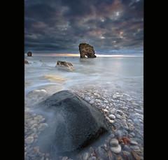 Silent Wave ~ (Reed Ingram Weir) Tags: seascape sunrise nikon arches pebbles lee coastline splash filters northeast cloudysky blackrock whitburn wavebreak d700 diyfilterholder reedingramweirphotography 1424mmlensrocksthisworld qualitylightforonce xprosized