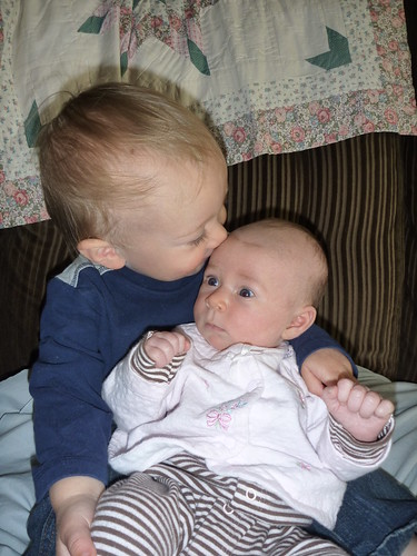 Silas loves his baby sister