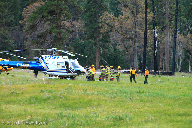 A CHP helicopter waits to airlift an injured climber to a local hospital. Photo by E. Howe. http://www.littleredtent.net
