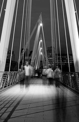 Hungerford Footbridge, London (mono) (Mo Baig) Tags: longexposure sunset urban blackandwhite bw motion london night mono nikon cityscape 201005 allrightsreserved hungerfordfootbridge tamron2875f28 platinumphoto nikond90 blackandwhiteurban nikonflickraward nikonflickrawardgold doublyniceshot tripleniceshot mobaig blinkagain
