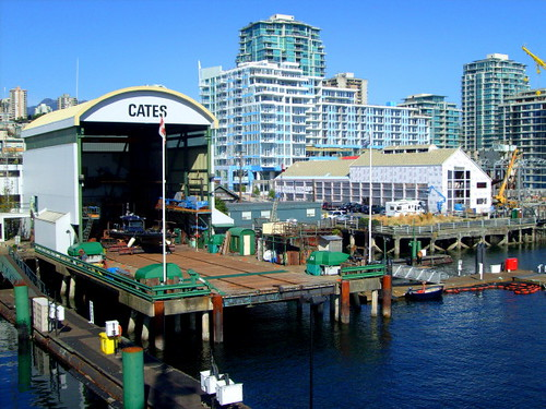 Lonsdale Quay in North Vancouver, dockside pier shipyard, and residential and office towers