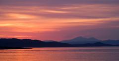 Craignish Sunset, Scotland 5 (chris-parker) Tags: sunset west silhouette clouds point coast scotland pier geese ben argyll goose more jura mull ardfern scarba lanndscape craignish