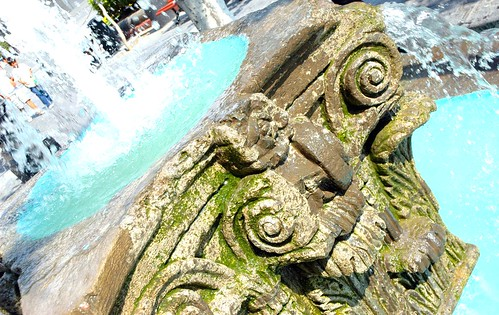 Mossy Corinthian capitol fountain in turquoise pool of water, Guadalajara, Jalisco, Mexico by Wonderlane