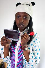 Funmi 15/05 (dgrendon) Tags: people girl fashion closeup portraits fun polaroid shoot photoshoot may lollipop pandahat funmi fashionportrait holdingpolaroid canon450d