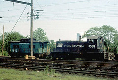 Penn Central EMD SW-1 # 8558 with an N 5 class caboose in Washington DC. August 1976.