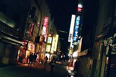 Akihabara alley (Timothy Slessor) Tags: city travel summer slr film japan night 35mm asian japanese tokyo shinjuku asia capital olympus 35mmfilm fujifilm nippon om1 olympusom1