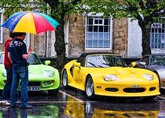DJChedgy_Marcos in the rain (Somerset Photo) Tags: bridge rain yellow umbrella impact marcoscar