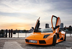 Lamborghini Murcilago (Pixelklinik) Tags: sunset sky orange black car skyline canon harbour hamburg 28 rims lamborghini sportscar murcilago 1755mm 40d