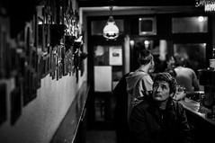 The photo wall. The living and the dead (AlphaAndi) Tags: monochrome menschen menschenbilder mono leute people personen portrait peoples portraits fullframe face friends freunde bar trier tiefenschärfe dof deepoffield sony schwarzweis sonyslta99v blackandwhite blackwhite bw bokeh bokehlicious