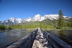 The road to Shambala (Jays and Jets) Tags: mountain stream bridge tetons grandtetonnationalpark nationalpark wyoming snow sky river