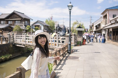 Happy young woman walking in old Japanese town (Apricot Cafe) Tags: img39402 2024years asia asianandindianethnicities japan japaneseethnicity japaneseculture katoricity sawarakatori sigma35mmf14dghsmart beautifulwoman blackhair bridge buildingexterior candid carefree charming cheerful chibaprefecture colorimage conicalhat cultures day enjoyment happiness horizontal lifestyles longhair lookingovershoulder oneperson onlyjapanese onlywomen onlyyoungwomen onoriverchibaprefecture outdoors people photography river smiling strawhat sustainablelifestyle threequarterlength toothysmile tourism tourist traveldestinations women youngadult katorishi chibaken jp