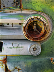 (shadowplay) Tags: tailight rust chrome oxidation faded junkyard composition circle