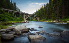 Rainbow Bridge (spudalicious1969) Tags: bridge idaho landscape longexposure mountain mountains outdoor payetteriver payetteriverbridge rainbowbridge river rocks smithsferry trees cascade unitedstates us