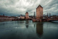 the two towers (Dennis_F) Tags: bridge sky france tower rain weather birds clouds frankreich day darkness angle seagull sony towers wide bad himmel wolken sigma wideangle strasbourg rainy strasburg dslr brcke turm mwe 1020 ultra trme uwa strassburg 10mm ultrawideangle sigmalens a700 sigma1020 uww pontscouverts sonyalpha sonydslr alpha700 sonya700 sonyalpha700 dslra700 sigma1020456 sigmaobjektiv gedecktebrcken