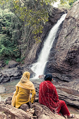 Soochippara Falls (christian.senger) Tags: travel red people woman india green nature water yellow digital forest geotagged grey waterfall nikon rocks asia outdoor stones gray kerala saree wayanad topaz lightroom d300 soochippara viveza christiansenger:year=2010 gettyvacation2010
