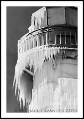 Lake Michigan Lighthouse (Michael Lavander) Tags: winter bw usa lighthouse snow ice canon pier frozen michigan stjoseph lakemichigan greatlakes saintjoseph bentonharbor stjoe northpier 70200f28l southwestmichigan greatlakeslighthouse 49022 outerlight canon40d 49085 michaellavander httpmlavcom mikemlavcom frozenlighthouse frozenlakemichiganlighthouse