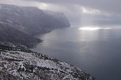 Winter on cape Aya (yuriye) Tags: winter light sea cloud sun snow black reflection silver aya ray russia cape balaklava sevastopol crimea крым мыс балаклава айя yuriye