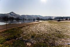Under the sun (Karmen Smolnikar) Tags: road sun nature water landscape village meadow hills slovenia slovenija karst kras planina fotocompetitionbronze intermittentlake yourwonderland