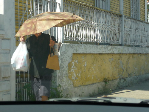Walking with an umbrella in Ponce