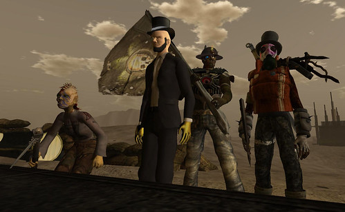 Fight Night finalists (l to r): Ccindy Pfeffer (1st), Paytrok Ghost (2nd), NeoBokrug Elytis (our host bearing the Wastelands flag), and Agustsa Jun (2nd).