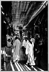 Souk in the Old Marrakech (B & W) (Beum Gallery) Tags: market hijab morocco maroc marrakech souk march djelaba urbanblackandwhite oldmedina   lanciennemdina