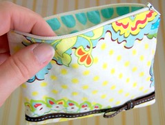 Yellow and Turquoise Zipper Pouch (bleuvanille) Tags: brown yellow turquoise vibrant sewing cream fabric pouch bow boucle zipper ribbon dots couture pochette amybutler ruban sunspots tissu heatherbailey fermetureclair popgarden