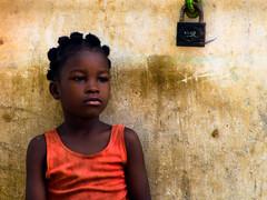 La petite vendeuse d'essence de Ouidah-Benin (Justinsoul) Tags: voyage africa leica trip travel portrait girl face flickr faces retrato cara portrt afrika benin paysage pays ritratto pais visage afrique ouidah     vlux1    fluidr justinsoul