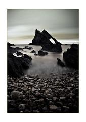 Bow Fiddle Rock (David-Seras) Tags: longexposure sea water canon landscape scotland rocks waves scottish pebbles shore 5d 1740mm 1740 2010 portknockie nd110 bowfiddlerock 10stopnd