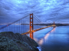 The Golden Gate Bridge at Dusk (Stuck in Customs) Tags: world sanfrancisco california travel bridge sunset sky usa west reflection water architecture modern clouds digital america photography golden bay design coast blog high nikon gate industrial dynamic stuck pacific suspension dusk united north scenic engineering structure processing imaging states february range span hdr tutorial travelblog customs 2010 route101 hdrtutorial stuckincustoms d3x stuckincustomscom