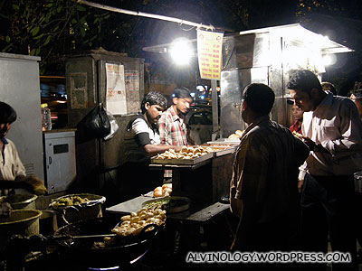 Street vendor; we usually try street food in other countries, but refrained here