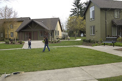 kids using common court between housing (rbubbs16) Tags: publicspace traces activities woodburn urbancontext exteriorspace rachelssitephotos