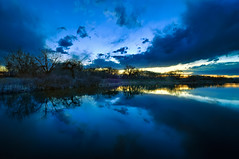 The Most Blue-tiful Time of Day (Fort Photo) Tags: blue trees sunset sky cloud lake reflection tree nature silhouette clouds landscape nikon colorado natural dusk fortcollins cottonwood area co bluehour hdr 2010 d300 clff runningdeer tokina1116