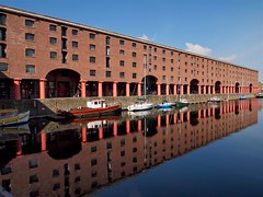 Albert Dock - Liverpool. (bawtrees) Tags: reflection water liverpool development albertdock olympuspenep2