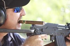 Guns and Cigars. (jonmallard) Tags: gun rifle guns cigars tobacco ak47 ak74 akm longgun