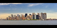 Lower Manhattan Skyline from the Staten Island Ferry, New York City (andrew c mace) Tags: city nyc panorama newyork skyline cityscape manhattan financialdistrict batterypark southstreetseaport brooklynbridge manhattanbridge statenisland batteryparkcity lowermanhattan statenislandferry piera newyorkbay 7wtc hugin goldmansachs onenewyorkplaza 7worldtradecenter nikoncapturenx nikonf1850mm nikond90