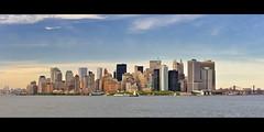 Lower Manhattan Skyline from the Staten Island Ferry, New York City (andrew c mace) Tags: city nyc panorama newyork skyline cityscape manhattan financialdistrict batterypark southstreetseaport brooklynbridge manhattanbridge statenisland batteryparkcity lowermanhattan statenislandferry piera newyorkbay 7wtc hugin goldmansachs onenewyorkplaza 7worldtradecenter nikoncapturenx nikonf1850mm nikond90