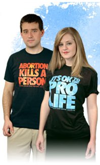 two white teens wear prolife t shirts. this is a staged photo