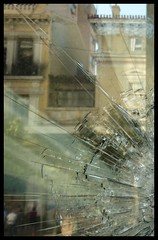violence anatomy (Nicos Xenos) Tags: building broken glass hellas bank athens panasonic greece anatomy violence imf burned nicos marfin