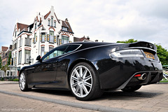 Aston Martin DBS (Thomas van Rooij) Tags: lighting street city trees light wallpaper sky sunlight black color reflection building ass car weather architecture clouds contrast photography design cool nikon shot angle thomas air side low arnhem rear great engine automotive pointofview exotic mansion gt nikkor rim rims luxury centrum coupe vr astonmartin sportscar spoiler 2010 v12 18105 60l carbonfibre d90 rooij powerbeautysoul thomasvanrooij