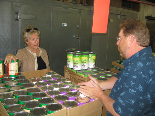 FNS Administrator Julie Paradis and Ron Rotzahn, Program Specialist, Helena, Montana Field Office, discuss food distribution challenges at the St. Ignatius Food Distribution center on the Flathead Reservation.