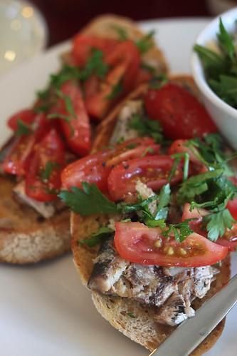 sardines on toast on a plate