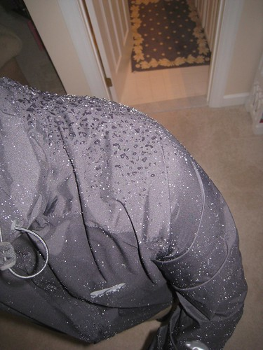 Water beading on the jacket's surface.