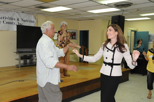 Deputy Administrator for SNAP Lisa Pino takes a break to dance with a senior citizen at the Little Havana Activities and Nutrition Center in Miami.   (USDA photo by Debbie Haston-Hilger).