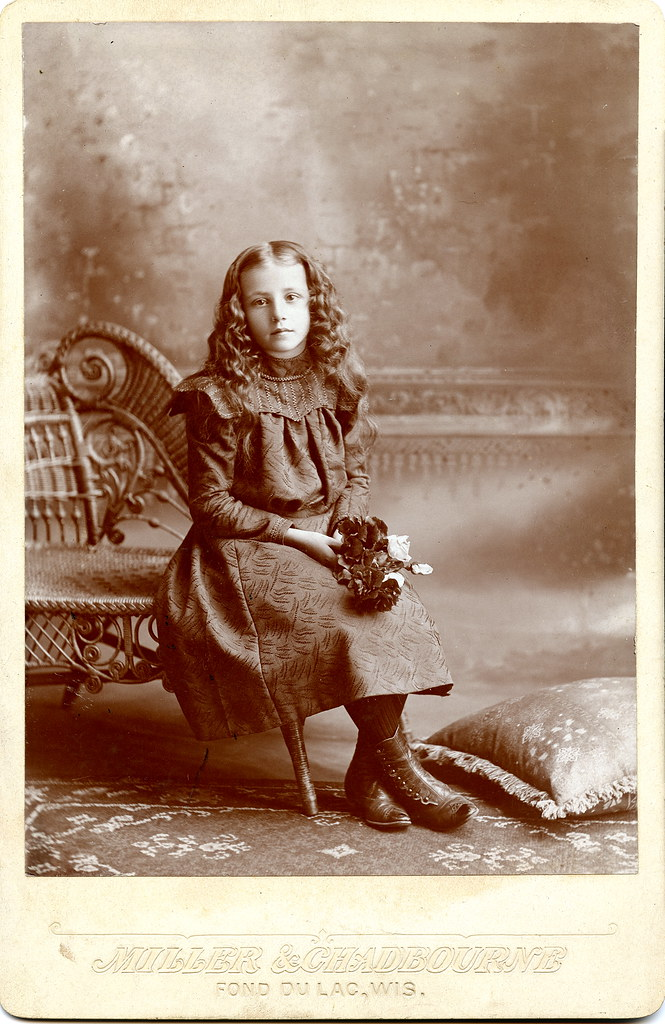 Seated Girl Holding Flowers Cabinet Card