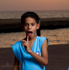 Catch you. (Mohd Althani) Tags: travel blue light boy sunset red sea summer portrait color love beach water coral night clouds canon toys eos photo day gulf flash bluewater 7d doha qatar frined portirait speedlite greatshots dukhan topshots photosandcalendar addawhah