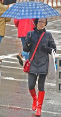 Hmmmm ... you're right: this outfit would be much better coordinated if I had a red umbrella. (Ed Yourdon) Tags: newyork rain manhattan broadway upperwestside peeps earmuffs umbrellas wellies rainboots sigersonmorrison