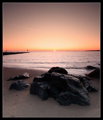 End of another day (Simon Rich Photography) Tags: sunset sea sky sun coast seaside sand rocks colours essex clacton starburst breakwater martello jaywick supershot simonrich mrmonts simonrichphotography