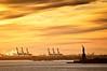 Mrs. Liberty welcomes the goods (dani.Co) Tags: sunset usa newyork yellow america puerto liberty harbor nikon harbour amarillo import ocaso export comercio estadosunidos nuevayork d300 materiales estatuadelalibertad 70200f28 importación materias fpg bej platinumphoto anawesomeshot danico exportación