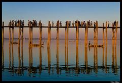 Amarapura rush hour (Dan Wiklund) Tags: bridge people lake reflection water boats evening wooden southeastasia footbridge burma crown myanmar rushhour d200 goldenhour 2010 amarapura ubeinbridge ubein taungthamanlake teakbridge lpbusy